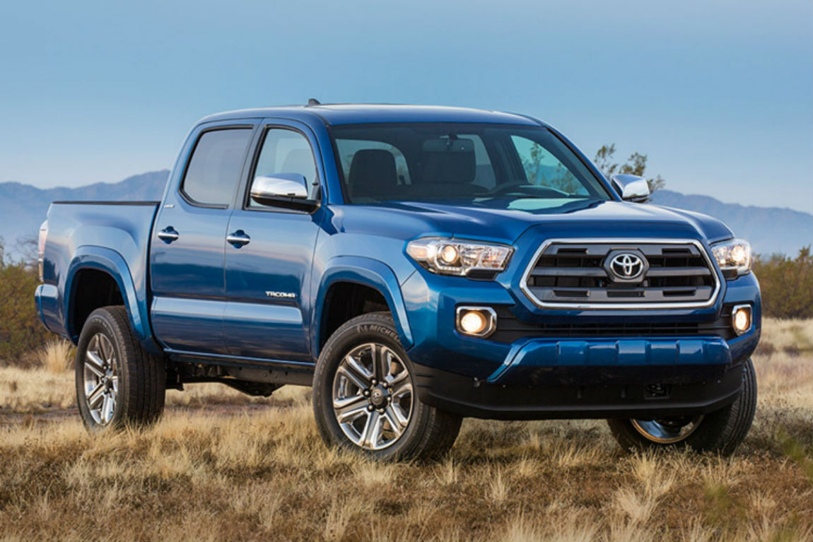 Passenger side exterior view of a blue 2016 Toyota Tacoma