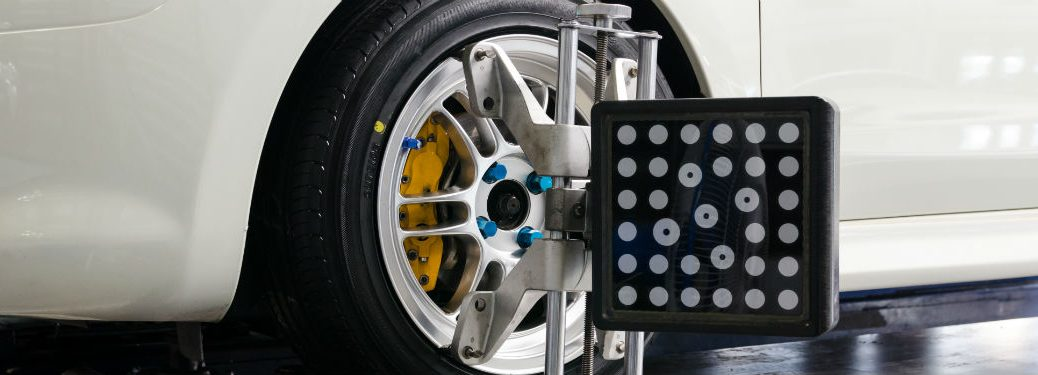 tire alignment device on close up of wheel