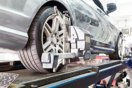 Close up of tire clamped in auto shop
