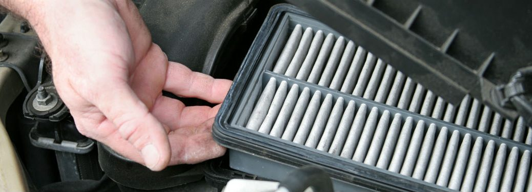 dirty car air filter getting taken out