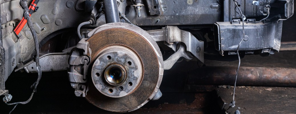 disassembled car with brake discs exsposed