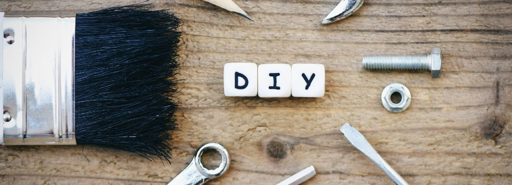 tools surrounding scrabble letters spelling out DIY
