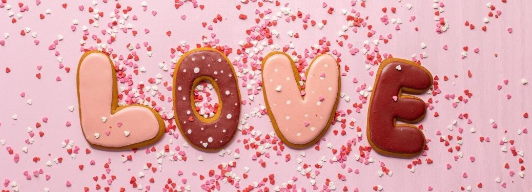 cookies spelling out love with heart sprinkles everywhere