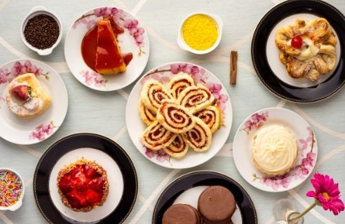 table full of variety of desserts and pastries