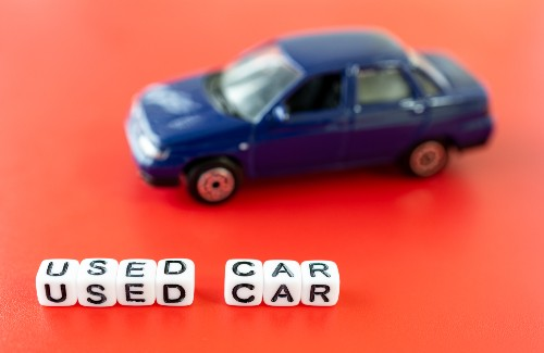 toy car with small letters spelling used car