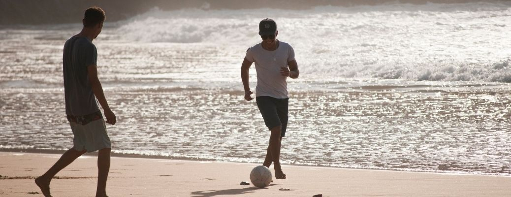 People playing football in beach