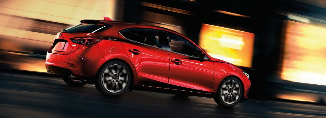 red mazda3 driving fast