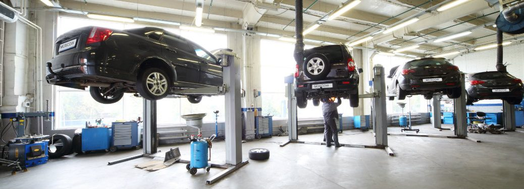 vehicles lifted in service shop