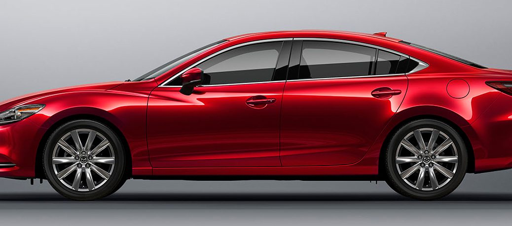 red mazda6 side view in white room