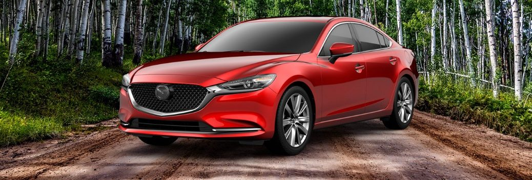 red 2019 Mazda6 in forest
