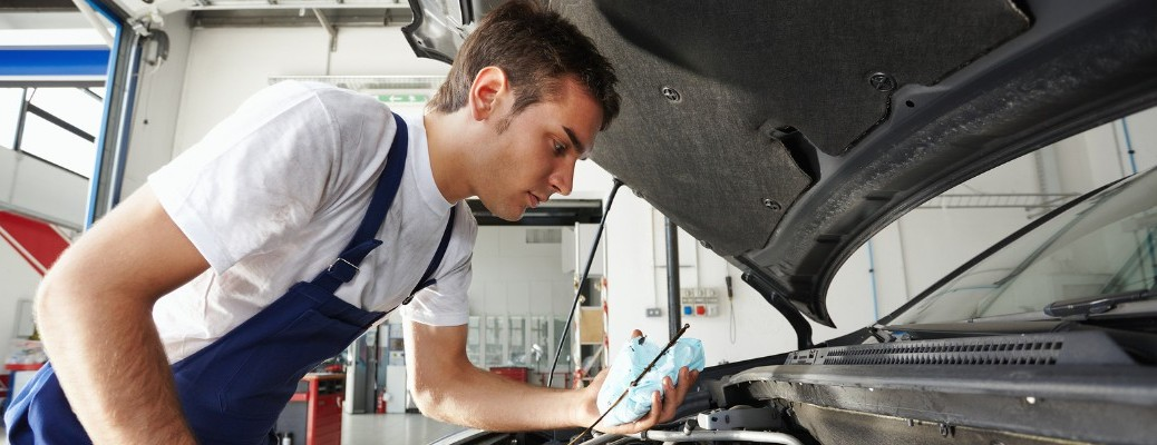 man working under the hood of a vehicle
