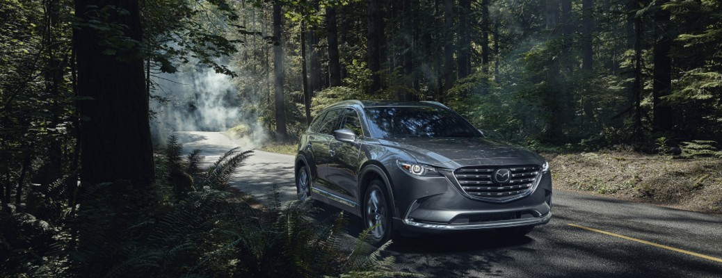 front view of the 2021 Mazda CX-9 in a forest