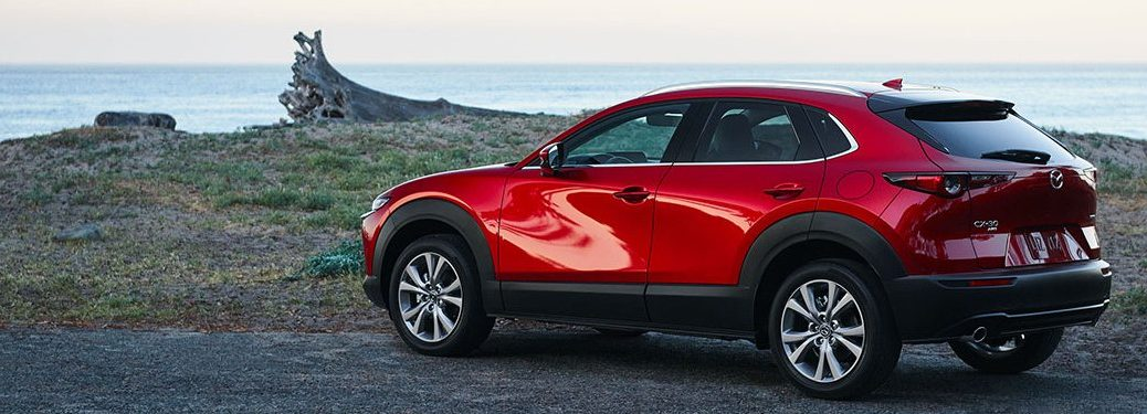 2021 Mazda CX-30 parked on a rocky outcropping overlooking the ocean