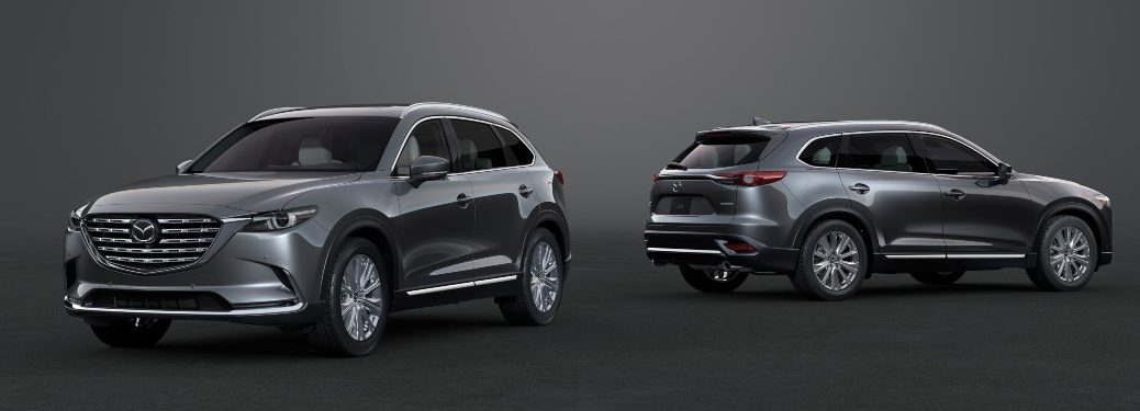 Two 2021 Mazda CX-9 models parked over an abstract background