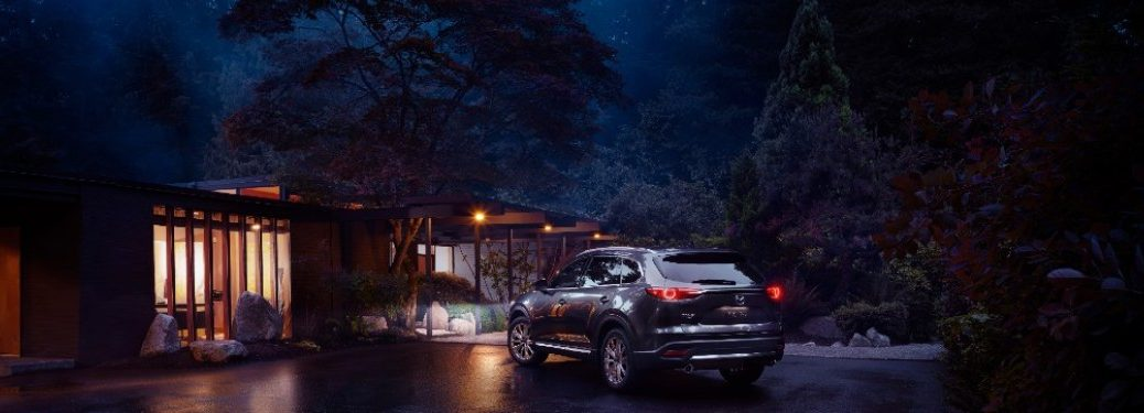 2021 Mazda CX-9 parked in front of a building