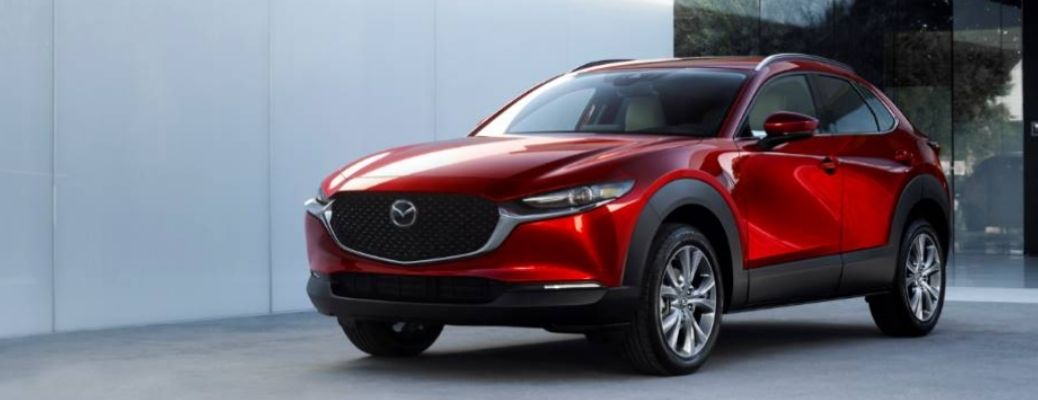Image of a red 2021 Mazda CX-30 in front of a building. What is the fuel economy rating of the 2021 Mazda CX-30?