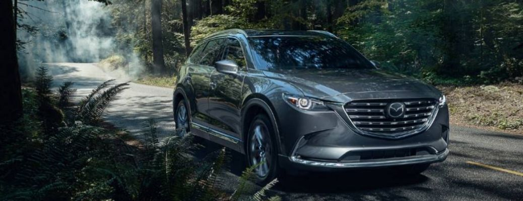 Grey 2021 Mazda CX-9 in country side. Know the safety features of the 2021 Mazda CX-9 in this blog