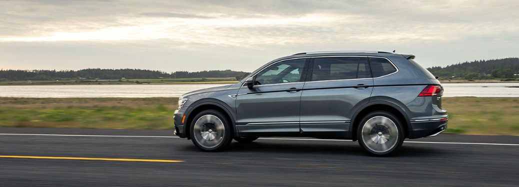 2020 VW Tiguan exterior driver side profile on road with lake