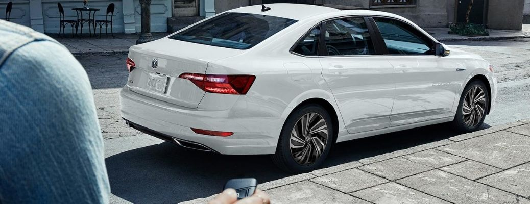 person remotely unlocking a parked 2020 VW Jetta
