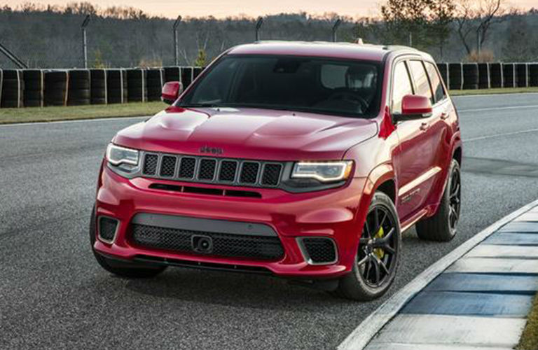 2020 Jeep Grand Cherokee red exterior front fascia driver side parked on race track