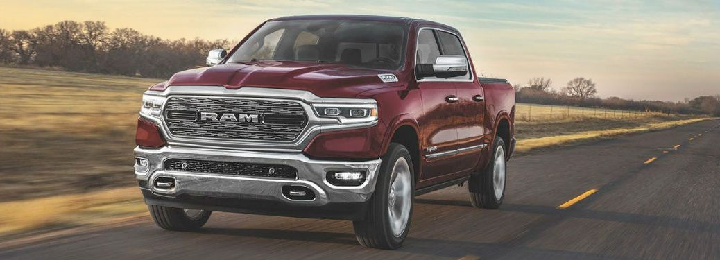 2020 Ram 1500 dark red exterior front fascia driver side driving