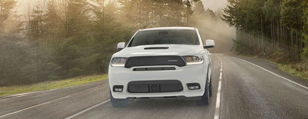 2020 Dodge Durango white exterior front fascia driving on forest road