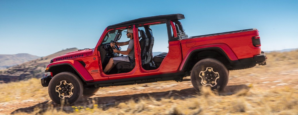 2021 Jeep Gladiator red exterior open doors driving in dry grass field