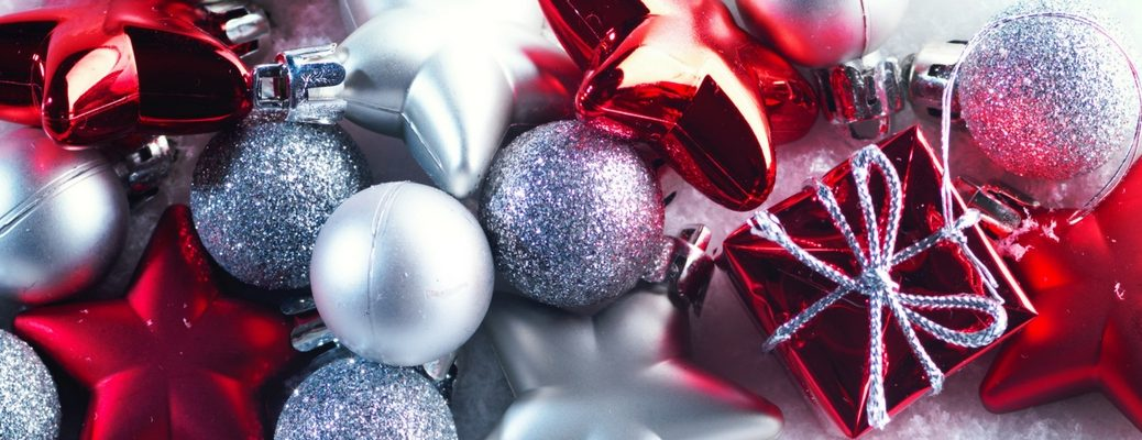 A collection of red and silver Christmas ornaments