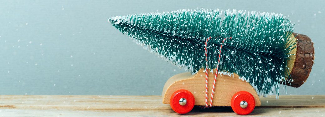 Toy car with Christmas tree on it