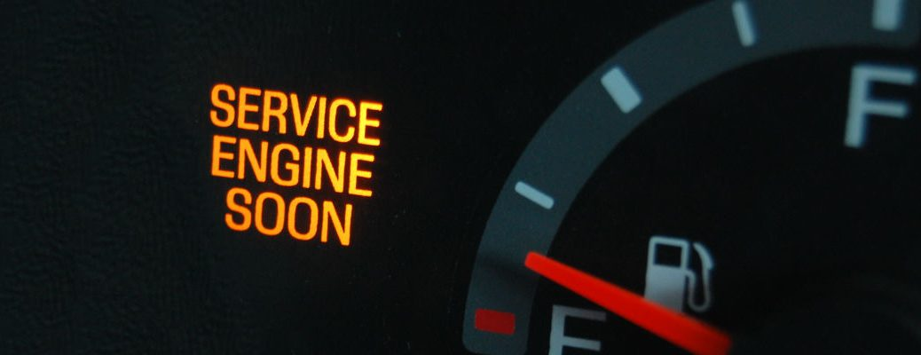 A stock photo of an activated check engine light.