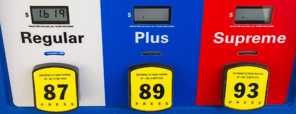 A stock photo of a gas pump with different grades.