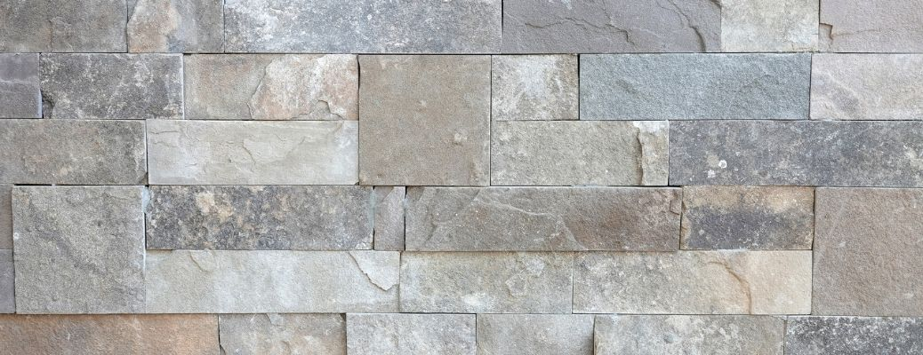 Granite tiles in a natural stone wall