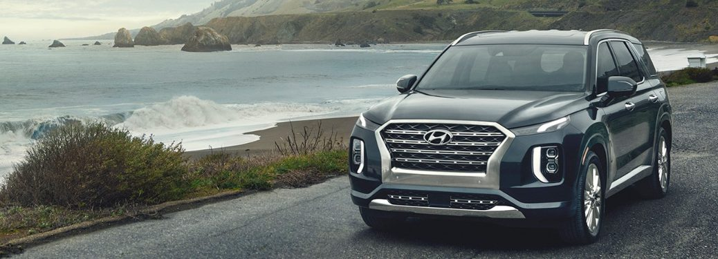 2020 Hyundai Palisade cruising down the road next to a lake