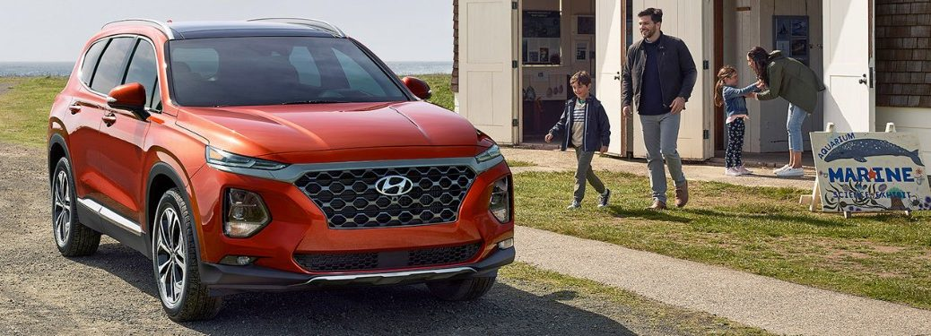 2020 Hyundai Santa Fe with father and son walking up to it