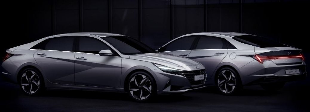 Two Silver 2021 Hyundai Elantra Models Front and Rear Exterior on Black Background