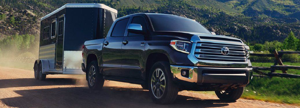 2020 Toyota Tundra pulling a trailer on a dirt road