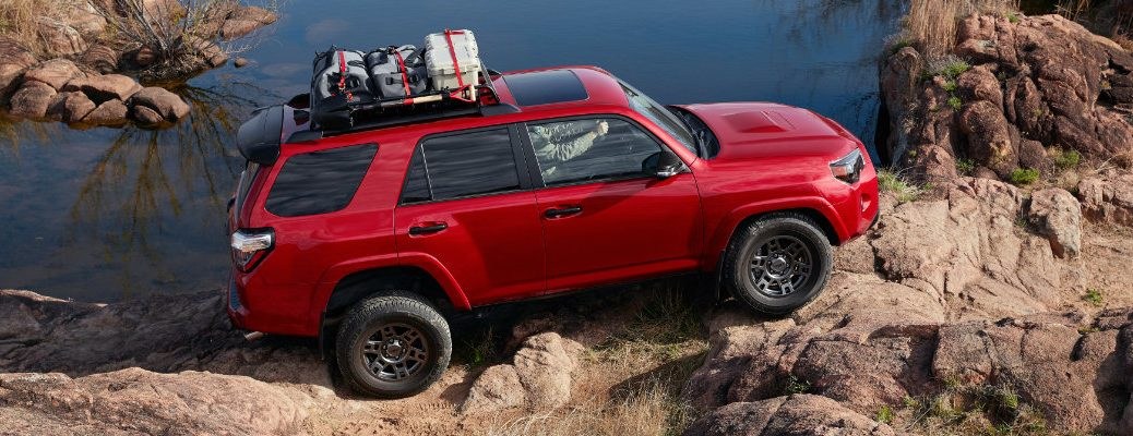 2020 Toyota 4Runner driving by a lake