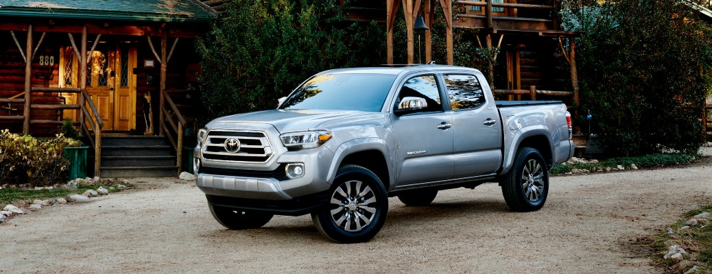 2020 Toyota Tacoma grey parked outside cabin on gravel