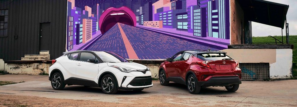 Two 2021 Toyota C-HR models in front of mural