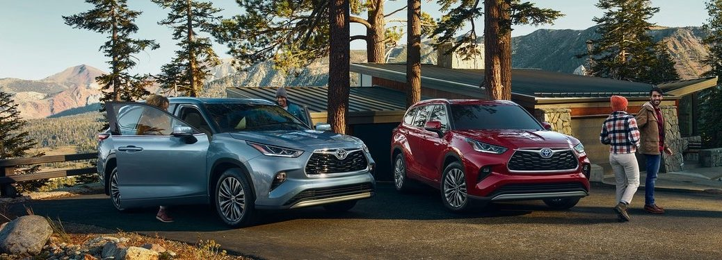 Two 2021 Toyota Highlander models with people
