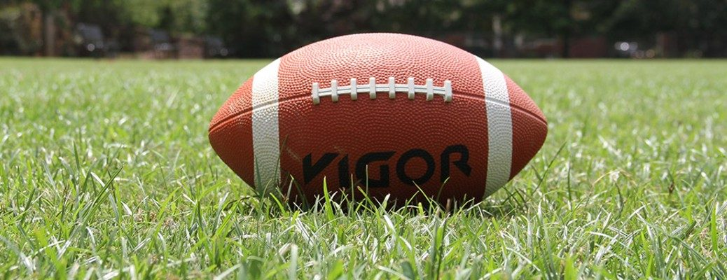 football laying in the grass