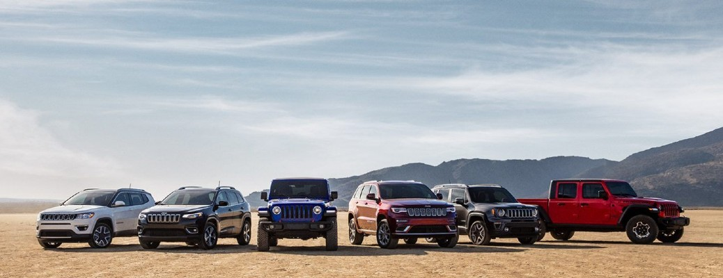 a variety of jeep vehicles in a row