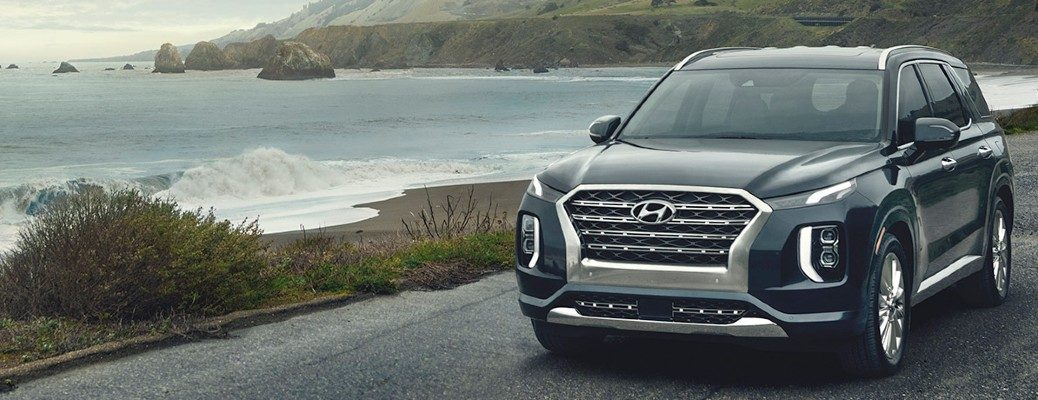 2020 Hyundai Palisade driving along an oceanside road
