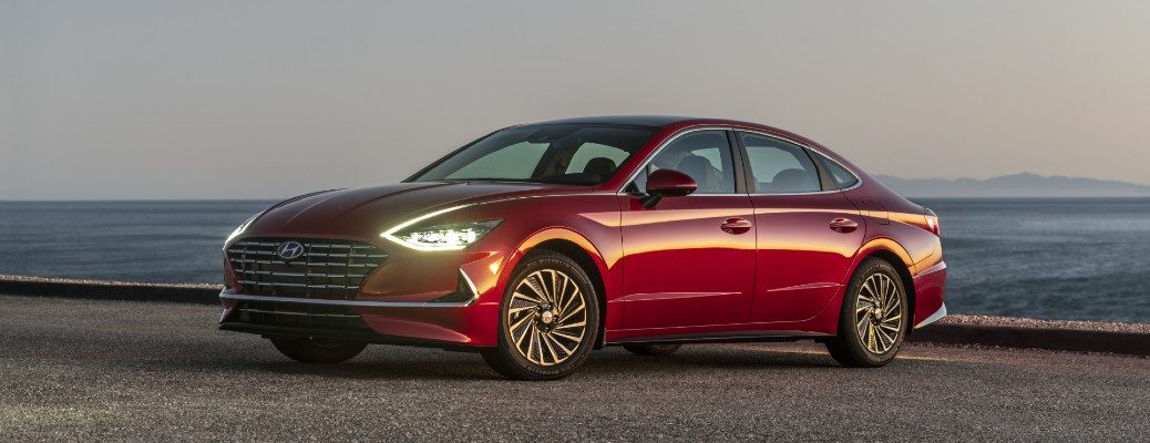 Red 2020 Hyundai Sonata Hybrid at a beach