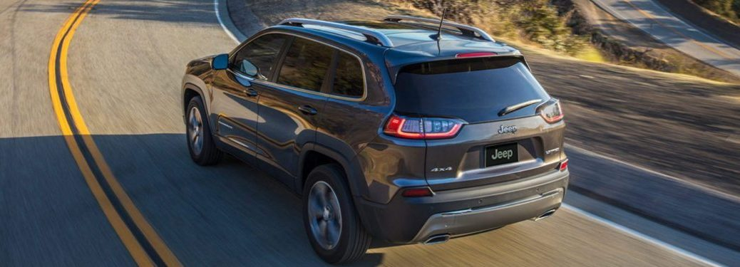 2020 Jeep Cherokee driving down a winding highway road