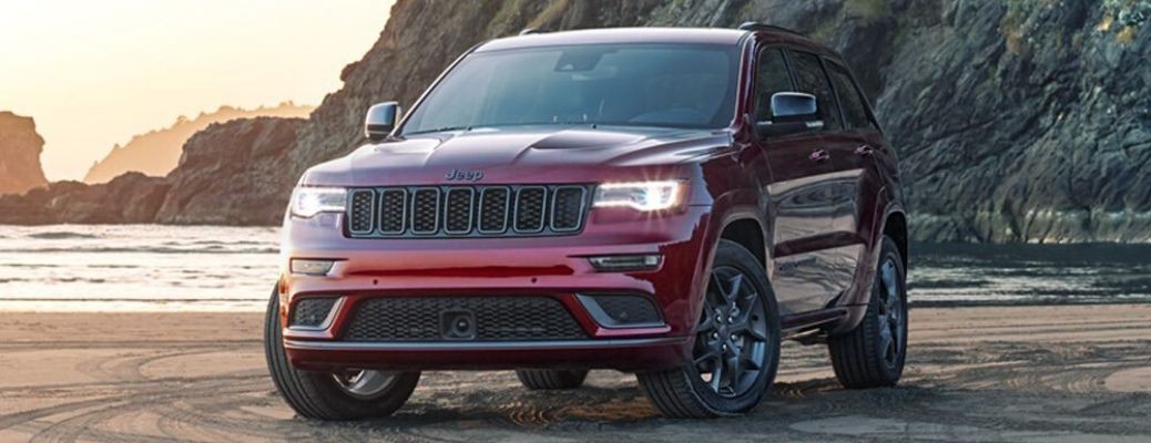 2020 Jeep Grand Cherokee parked on the sand and near water
