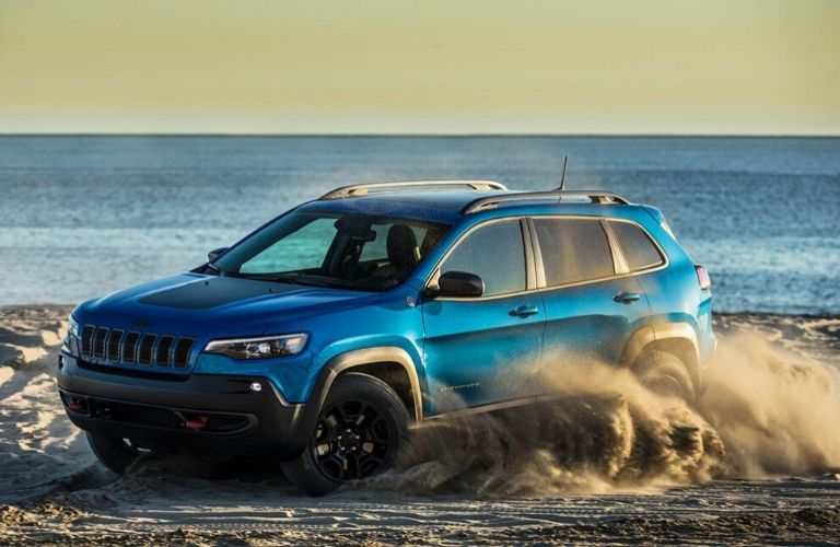 2020 Jeep Cherokee driving on the sand