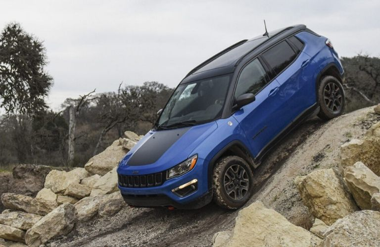 2020 Jeep Compass driving at an incline