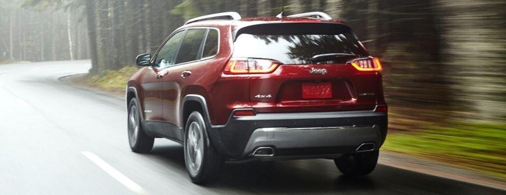 2021 Jeep Cherokee driving rear view