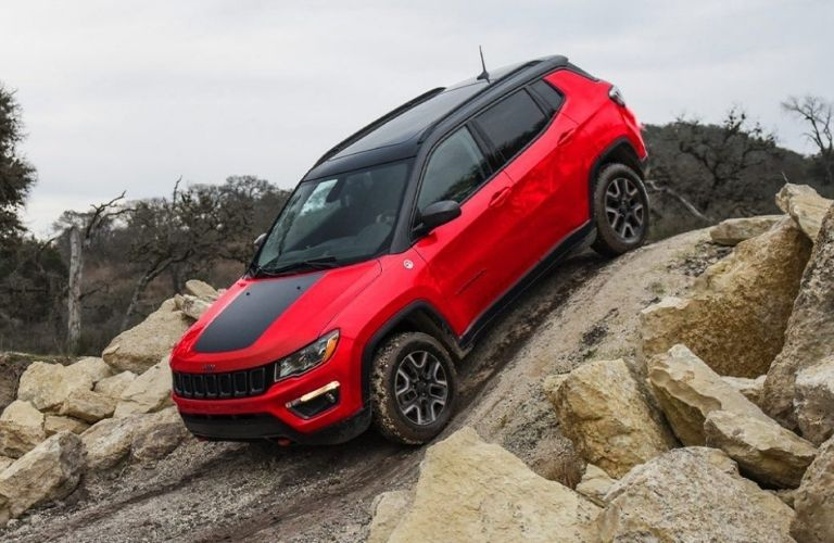 2021 Jeep Compass parked on rocks
